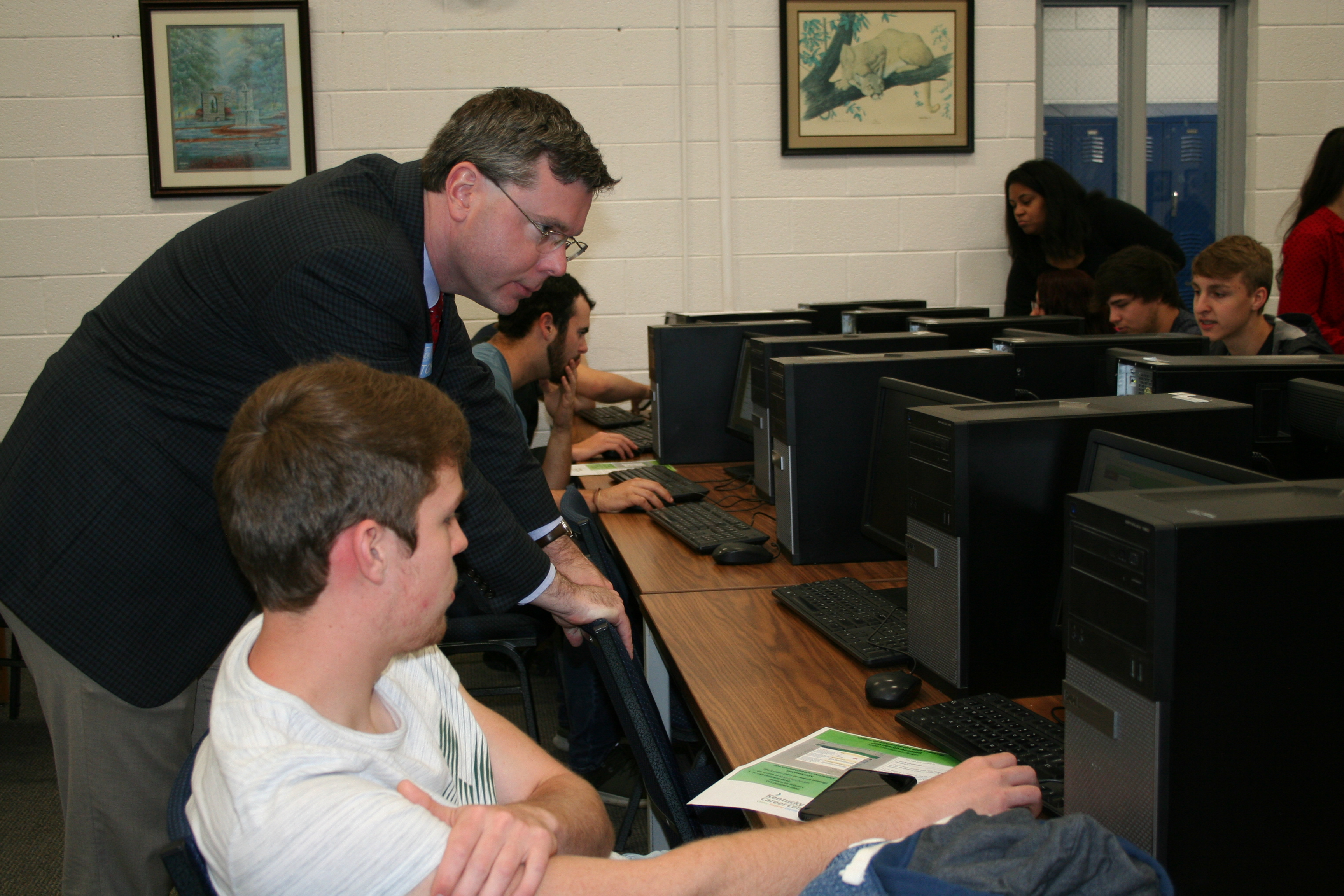 Community business representatives help LC student work on resume