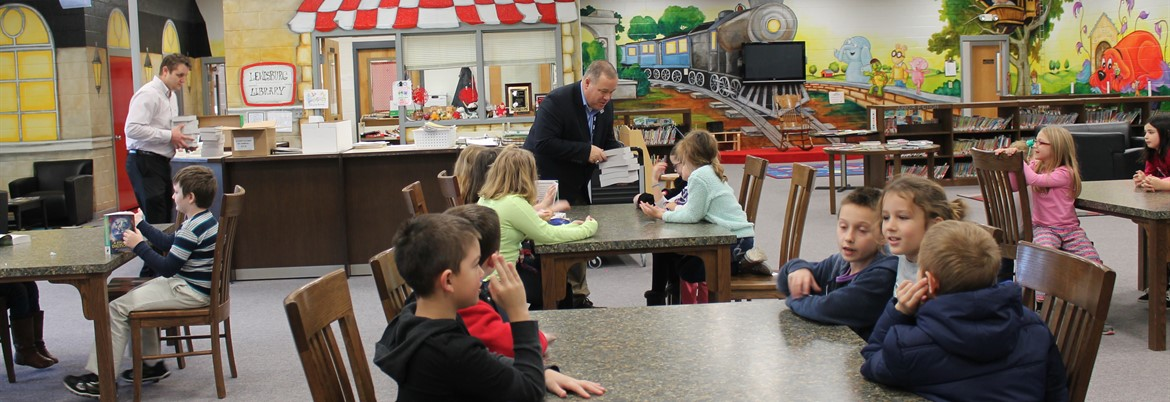 Rotary Club presenting dictionaries to the third grade